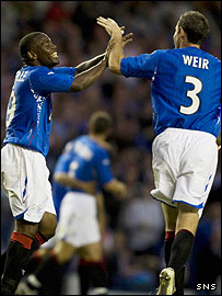David Weir and Jean-Claude Darcheville celebrate the opening goal