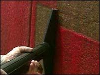 Argonne super gel is vacuumed off a wall