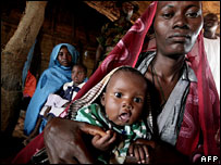 Displaced Sudanese woman with her son in Darfur - file photo