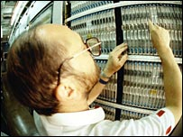 BT engineer in a telephone exchange