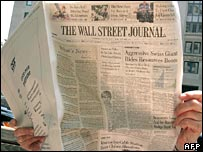 Person reading Wall Street Journal