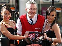 Lembit Opik, flanked by the Cheeky Girls