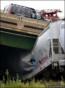 Train crushed under section of collapsed bridge on Mississippi river at Minneapolis