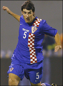 Vedran Corluka has signed a five-year contract subject to a work permit being granted