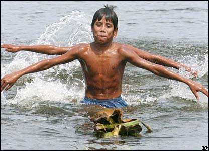 Boys play in floodwaters in Sirajganj, Bangladesh. (02/08/07)