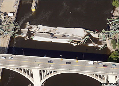 Aerial view of the collapsed I-35W bridge over the Mississippi river