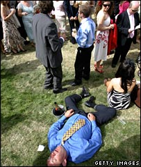 A man rests after drinking champagne at Ascot