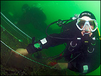 Diver from Hampshire and Wight Trust for Maritime Archaeology excavating on the site (copyright Simon Brown)