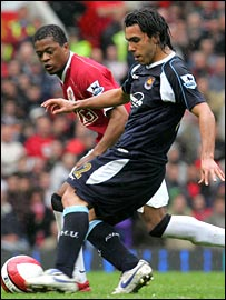 Carlos Tevez (right) in action against Manchester United last season.