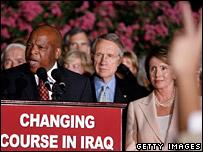 Congressman John Lewis speaks while Senate Majority Leader Harry Reid and Speaker of the House of Representatives Nancy Pelosi listen during a rally in Washington