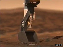 Scoop on end of robot arm  Image: Nasa