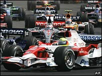 Fernando Alonso's McLaren behind Ralf Schumacher's Toyota at the start of the Hungarian Grand Prix