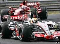 Lewis Hamilton fends off Kimi Raikkonen during the Hungarian Grand Prix