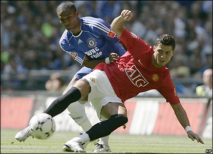Malouda and Ronaldo contest possession
