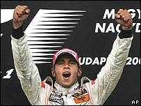 Lewis Hamilton celebrates on the podium after winning the Hungarian Grand Prix