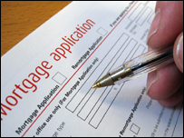A mortgage application being filled in