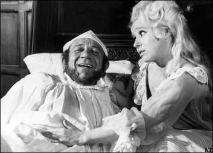 Sid James and Barbara Windsor in Carry On Henry