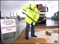 DARD officials disinfectant mats at the port of Larne outside Belfast