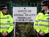 Police officers at the Pirbright complex