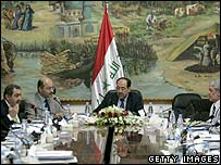 Prime Minister Nouri Maliki (centre) presides over a cabinet meeting (3 July)