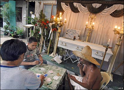 Group plays card at a wake in Manila, Philippines