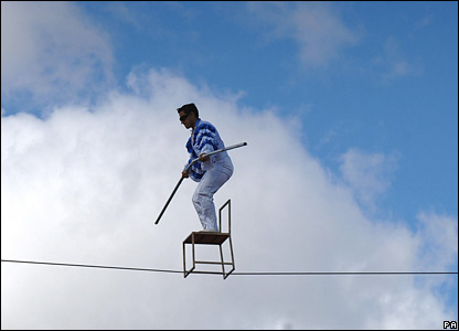 Colombian Henri Ayala balances on a chair on a high wire in York, UK