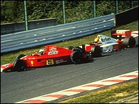 Ayrton Senna drives his McLaren into the back of Alain Prost's Ferrari at the 1990 Japanese Grand Prix
