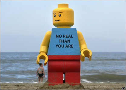 A huge Lego toy about 2.5m tall on the beach at Zandvoort, Holland.