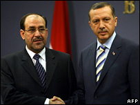 Iraqi PM Nouri Maliki and his Turkish counterpart, Recep Tayyip Erdogan, shake hands