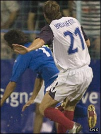 Slaven Stjepanovic is challenged by Rangers' Kirk Broadfoot