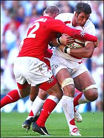 Simon Shaw takes the ball forward against Wales