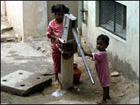 Children pumping water