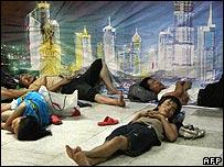 Migrant workers sleeping in Shanghai