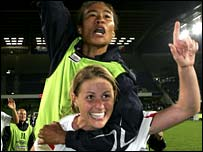 Kelly Smith and Rachel Yankey celebrate England's qualification for the World Cup following a draw with France in 2006