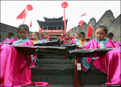 Students play instruments at the Great Wall of China
