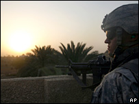 US soldier looks over a rooftop in western Baghdad (2 August 2007)