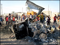 Iraqis examine a destroyed US military humvee in Baghdad (June 2007)