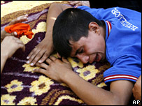 An Iraqi weeps over his father's coffin outside a hospital in Sadr City - 08/08/07