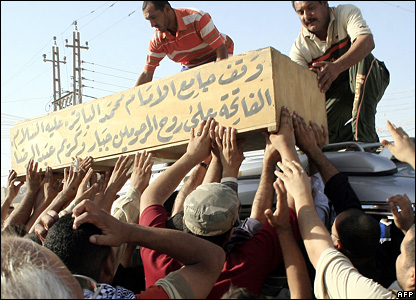 The coffin of one of those killed in the air strike is loaded onto a van