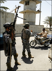 Iraqi policemen at a checkpoint outside Sadr City