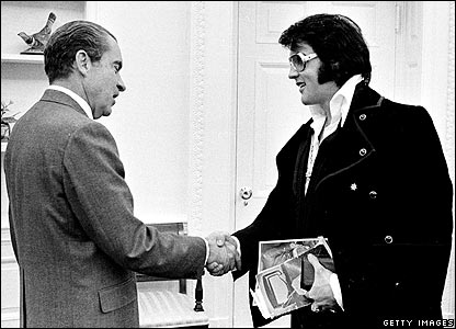 President Richard Nixon shakes hands with Elvis Presley December 21, 1970 at the White House.