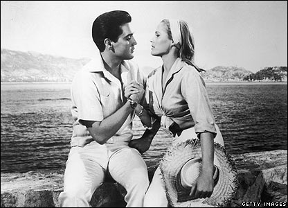 Elvis Presley holds the hand of Ursula Andress in a still from the film Fun in Acapulco, directed by Richard Thorpe, 1963.