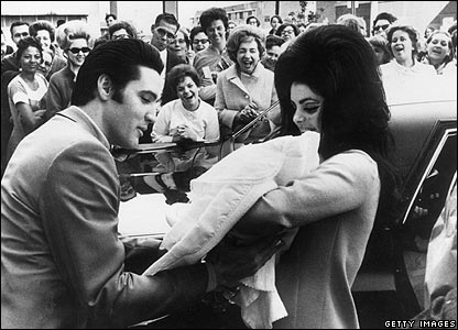 13th February 1968:  Elvis and Priscilla Presley with their daughter, Lisa Marie, born on 2nd February.