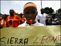 Supporters campaign in Sierra Leone ahead of the elections