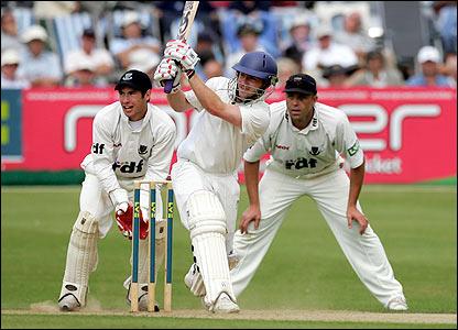 Warwickshire's Ian Westwood hits a boundary