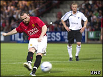 Wayne Rooney scores from the spot at East End Park