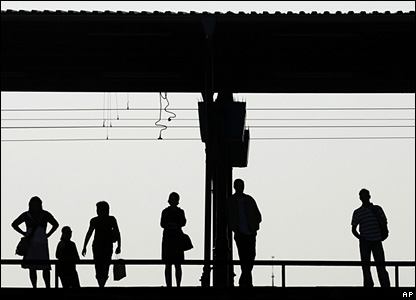 Passengers wait for a train at the German commuter station of Ostkreuz prior to the start of a strike