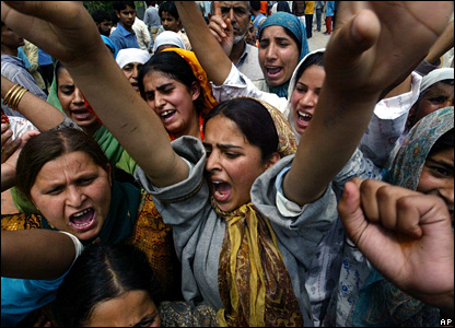 Kashmiri women shout anti-Indian slogans during a protest against the arrest of a girl by paramilitary forces during a raid in Maloora, India