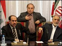 Nouri Maliki (l) and Iranian Vice-President Parviz Davoodi (r)