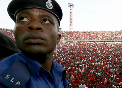 Policeman at a campaign rally in Sierra Leone